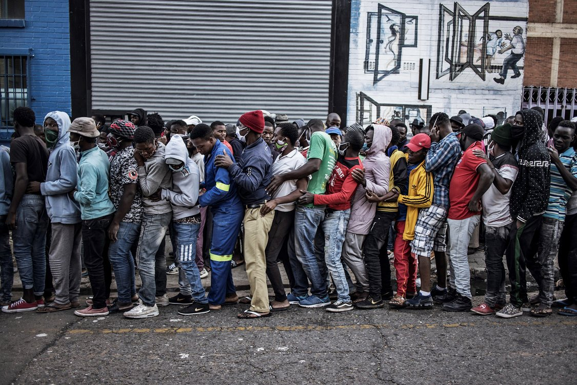 People queue tightly to receive food in Johannesburg, South Africa.