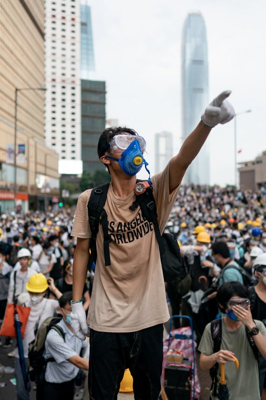 A protester makes a gesture during a protest