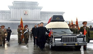 Kim Jong-un and other top North Korean officials accompany the coffin of Kim Jong-il during the late leader's funeral procession.