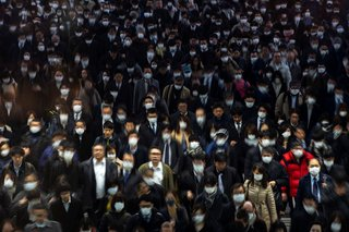 Crowds wearing protective masks at Shinagawa Station in Tokyo, March 2, 2020.